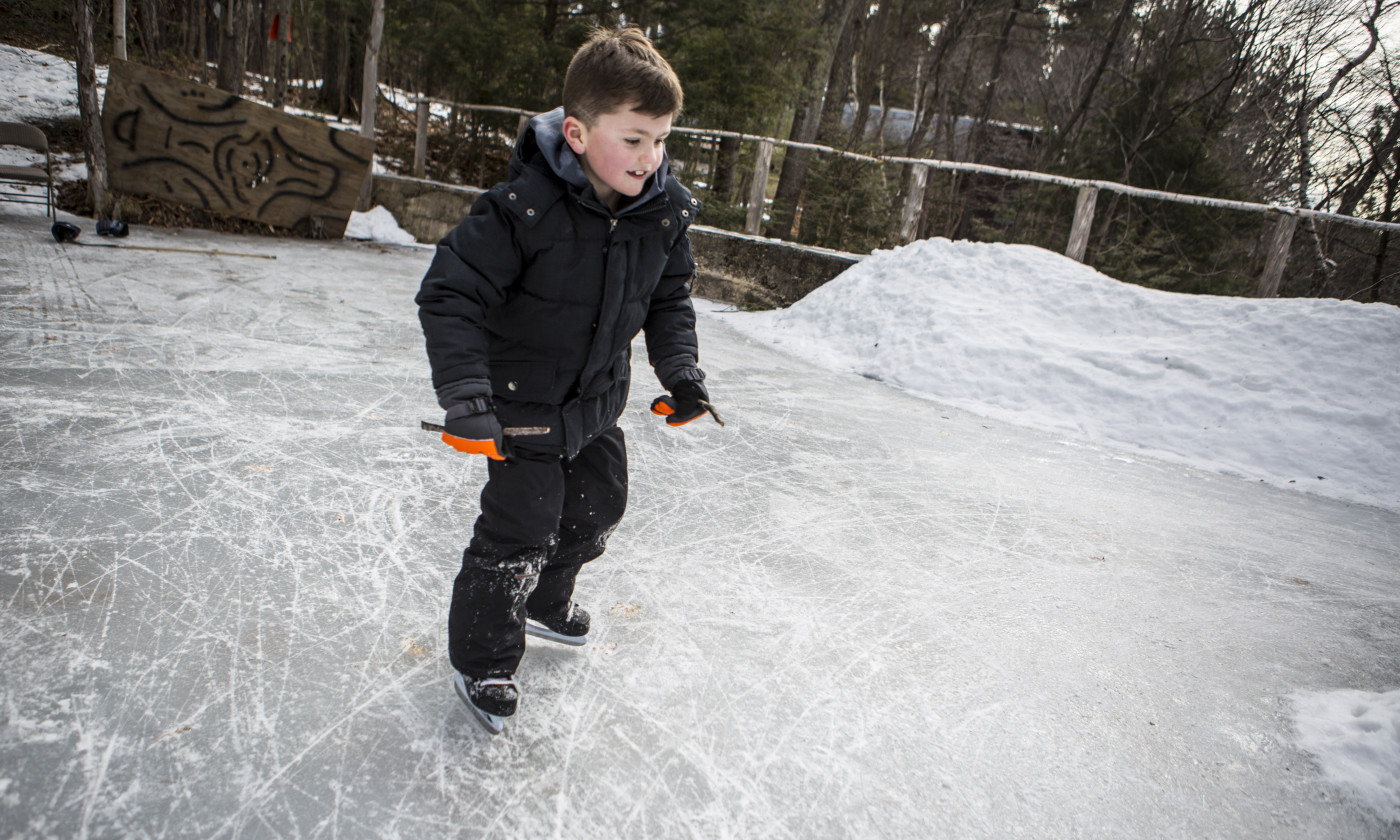 Boy skating on Adirondack pond