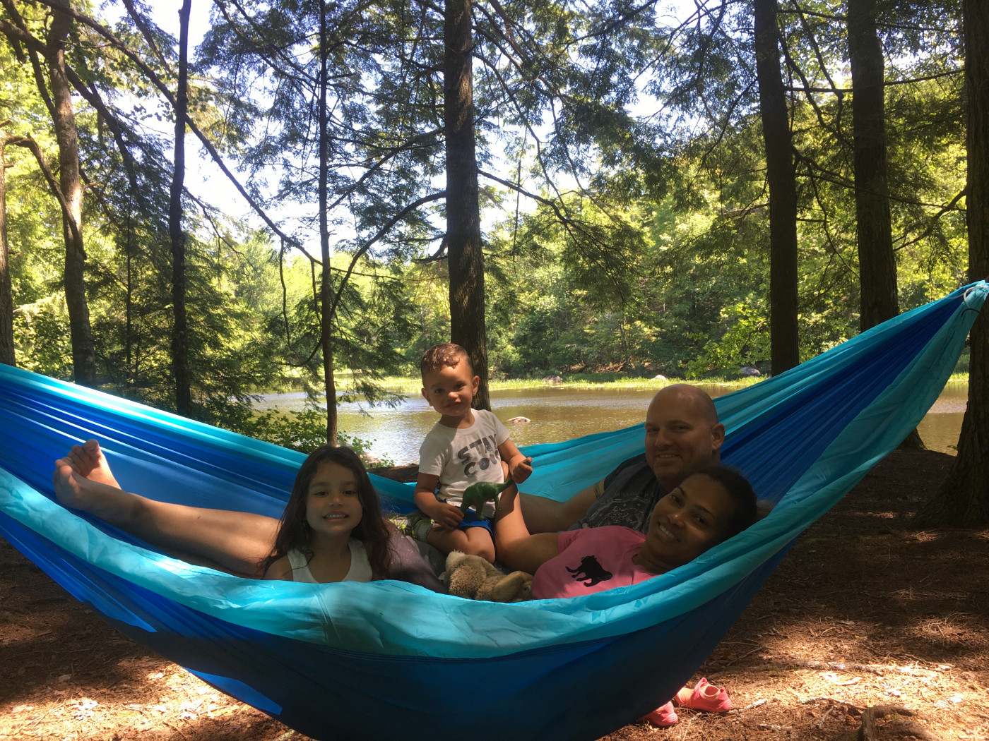 A family of happy campers enjoying Lewey Lake Campground.
