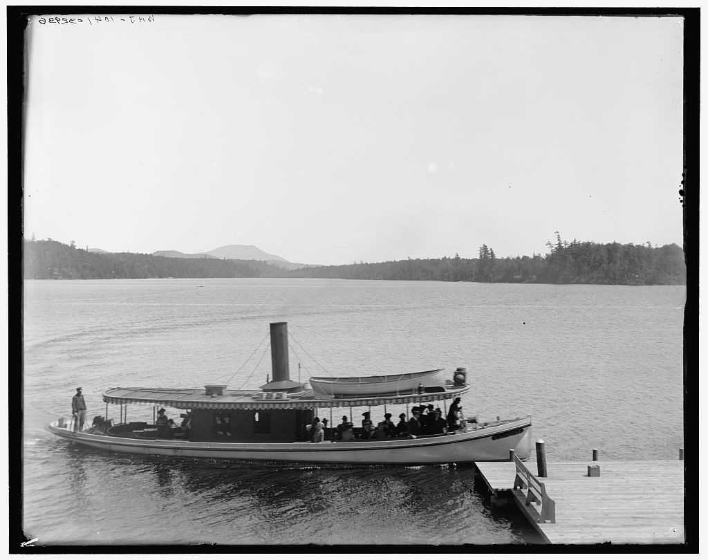 A launch on Raquette Lake, early 1900s. Image courtesy Library of Congress.