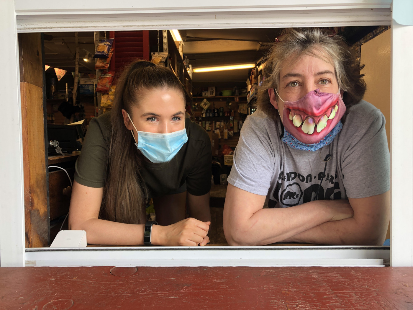 Owner Vickie Sandiford and Employee at Takeout Window